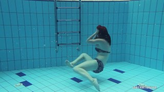 Preview 3 of Redheaded Katrin stripping underwater