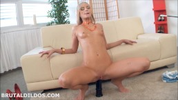 Fit blonde babe fucking both her holes with a big black brutal dildo in HD
