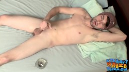 Bearded straight jock tugging and wanking his big dick solo